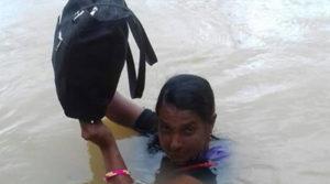 Binodini Samal - teacher wades in neck-deep water to reach school