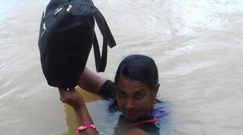 Binodini Samal - teacher wades in neck-deep water to reach school